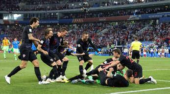 Die Spieler der kroatischen Nationalmannschaft bejubeln den Einzug ins WM-Halbfinale 2018.