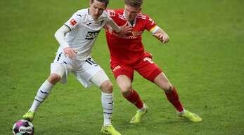 Hoffenheims Mittelfeldspieler Sebastian Rudy (l) und Unions Mittelfeldspieler Marius Bülter.