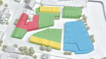Das Modell vom neuen Stadtquartier in der nördlichen Innenstadt zeigt die verschiedenen Bereiche: Sparkasse (rot), Handel und Gastro (grün), Handel und Versorgung (blau) sowie Wohnen (gelb). Hinten rechts ist die alte Stadthalle zu sehen.