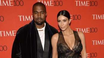 Kanye West und Kim Kardashian sind glücklich.