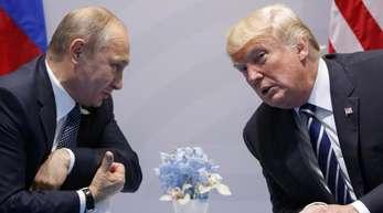 Kreml-Chef Wladimir Putin (l.) und US-Präsident und Donald Trump bei einem Gespräch auf dem G20-Gipfel in Hamburg.