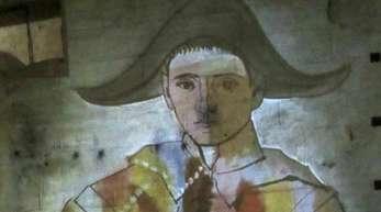 Die Projektion des Werks «Harlekin mit gefalteten Händen» von Pablo Picasso wird bei der Multimedia-Schau «Picasso und die spanischen Meister» in den Steinbrüchen Carrières de Lumières an eine Wand geworfen.