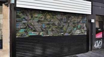 Die Hälfte ist weg. Banksy-Graffito in Bristol.
