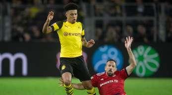 Jadon Sancho (l) unterschrieb beim BVBund nicht in München.