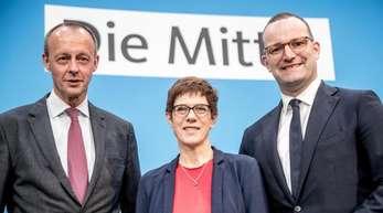 Die drei Politiker wollen sich beim Parteitag für die Nachfolge von Merkel im Amt des CDU-Bundesvorsitzenden bewerben.