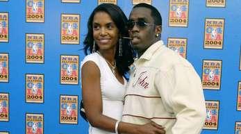 Das amerikanische Model Kim Porter (l) und der Musiker Sean«Diddy»Combs (2004).