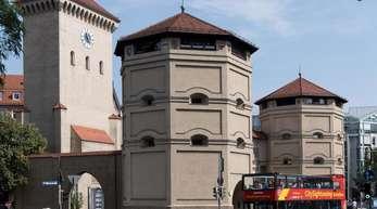Das Isartor aus dem 14. Jahrhundert in München. Solche Sehenwürdigkeiten ziehen immer mehr Touristen an.