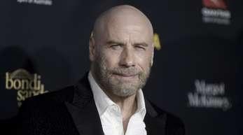 John Travolta gefällt sich auch ohne Haare.
