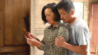 Yong Mei (l) und Wang Jingchun in einer Szene des letzten Wettbewerbfilms «Di jiu tian chang».