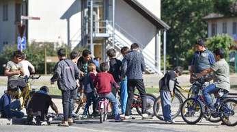 Flüchtlingskinder spielen in einer Unterkunft in Heidelberg. Foto. Uwe Anspach