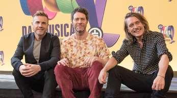 Entspannt im Hier und Jetzt:Gary Barlow (l-r), Howard Donald und Mark Owen.