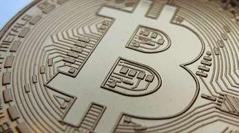 Eine Bitcoinmünze. Der Bitcoin ist die älteste und bekannteste Digitalwährung.