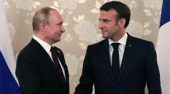 Suchen den Dialog: Kremlchef Wladimir Putin (l) und Frankreichs Präsident Emmanuel Macron.