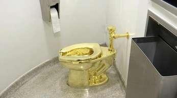 Die 18-karätige goldene Toilette «America» des italienischenKünstlersMaurizio Cattelan.