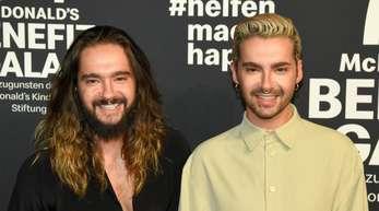 Tom und Bill Kaulitz (r) bei der McDonald's Benefizgala in München.