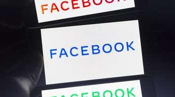 Das neue Firmenlogo von Facebook auf einem Smartphone-Bildschirm.