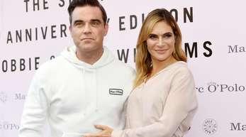 Robbie Williams mit Ehefrau Ayda bei der Vorstellung seiner Mode-Kollektion.