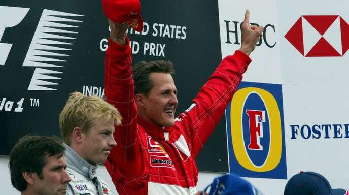 Michael Schumacher bei seinem vorletzten WM-Sieg im September 2003. Er ist der erfolgreichste Pilot der Formel-1-Geschichte.