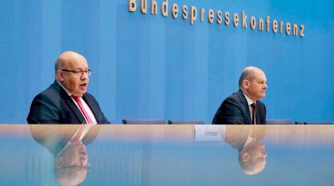 Wirtschaftsminister Peter Altmaier und Finanzminister Olaf Scholz kündigen an, nicht zu kleckern, sondern zu klotzen.
