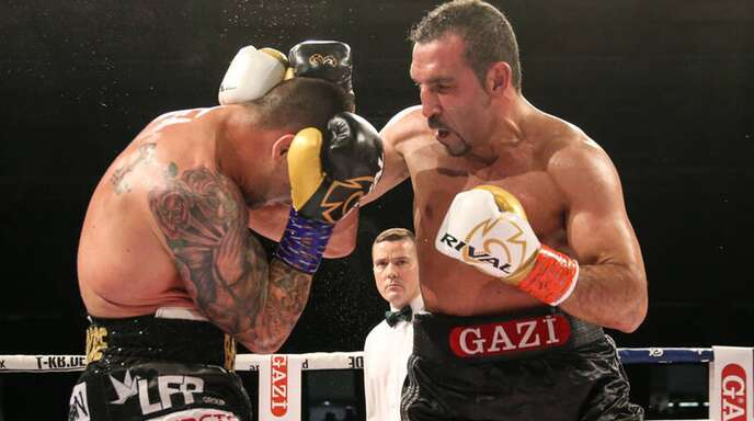 """Boxer Firat Arlsan (re.) hat einen Traum: """"Ich will noch einmal Weltmeister werden."""""""
