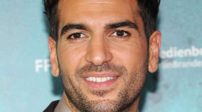Der Schauspieler Elyas M'Barek spürt ein Klima der Feindseligkeit in Deutschland.