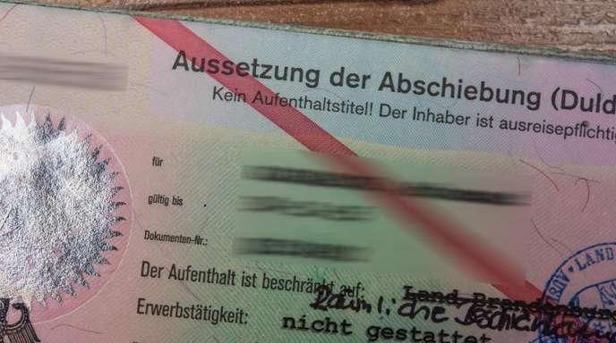 Ausweis eines Asylbewerbers.