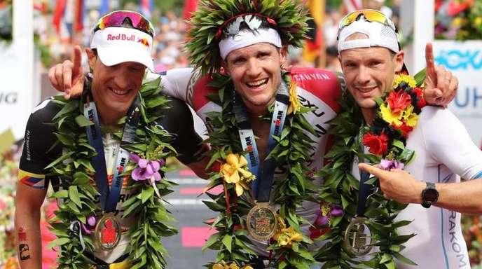 Sebastian Kienle (l-r), Jan Frodeno und Patrick Lange.