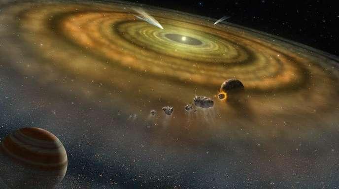 Gas und Staub umkreisen in einem jungen Planetensystem eine Sonne.