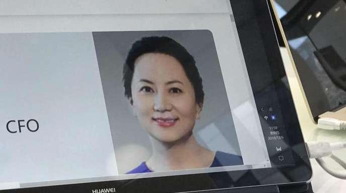 Ein Porträtfoto von Meng Wanzhou, Finanzvorstand des chinesischen Smartphone-Herstellers Huawei, ist auf einem Huawei Computer zu sehen.