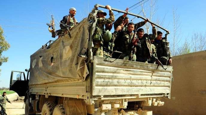 Syrische Soldaten in Ost-Ghuta: Die Entwicklung zeigt, wie sich nach dem angekündigten Truppenabzug der USA die Allianzen in Syrien neu sortieren.