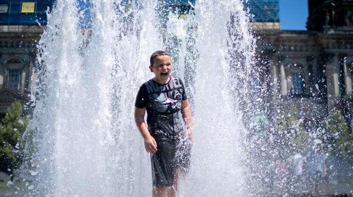 Abkühlen im Brunnen: Berlin wird bis 2050 so warm wie das australische Canberra.