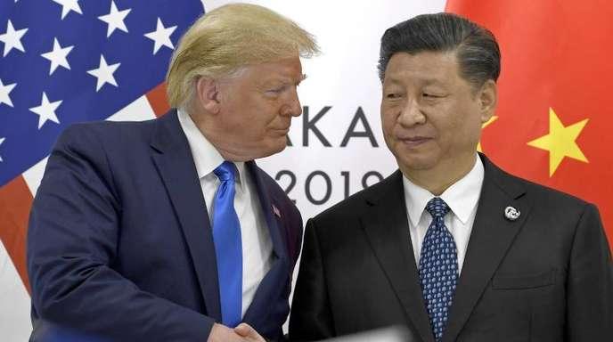 US-Präsident Donald Trump und sein chinesischer Amtskollege Xi Jinping Ende Juni bei einem Treffen in Japan.