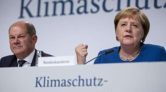 Bundeskanzlerin Angela Merkel und Bundesfinanzminister Olaf Scholz bei einer Pressekonferenz am 20. September zu den Ergebnissen der Sitzung des Klimakabinetts.
