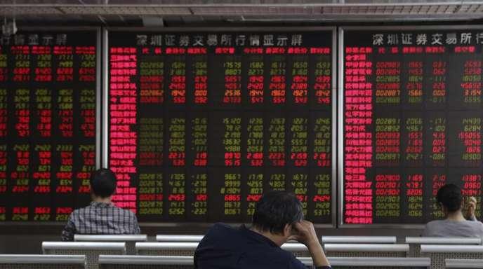 Investoren beobachten die Aktienkurse am Aktienmarkt. Vor Gesprächen zur Lösung des Handelskrieges zwischen den USA und China, den beiden größten Volkswirtschaften, rutschten die Aktien in Asien ab.