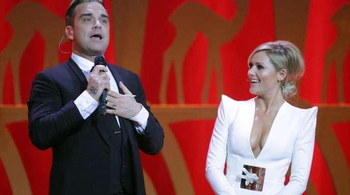 In der Gegenwart von Helene Fischer fühlt sich Robbie Williams wohl.