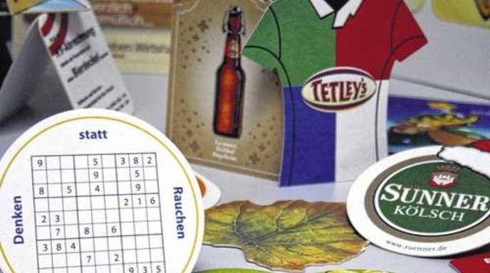 Foto: Christel Stetter - Dem Design sind keine Grenzen gesetzt: Die meisten Bierdeckel auf der Welt stammen aus dem Hause Katz. In den USA liegt der Marktanteil sogar bei 97 Prozent.